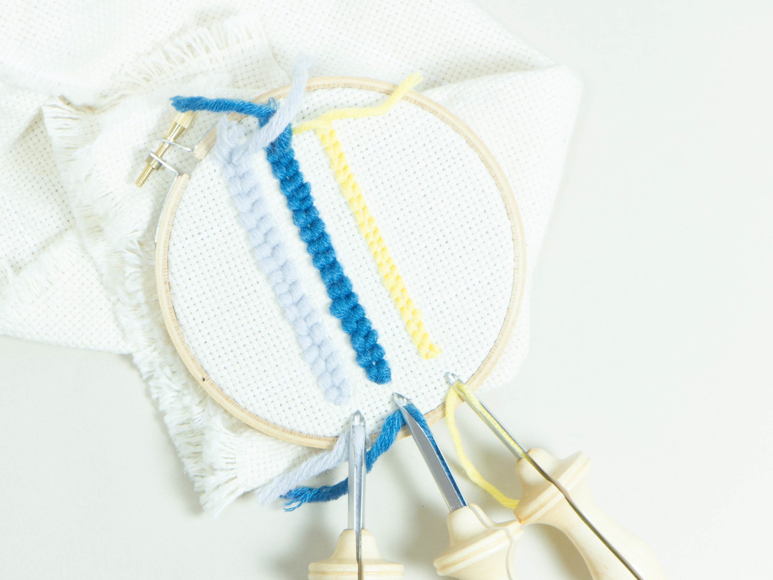 From left to right: #10 Regular with light blue yarn, #9 Regular with blue yarn,  #10 Fine  with yellow yarn.