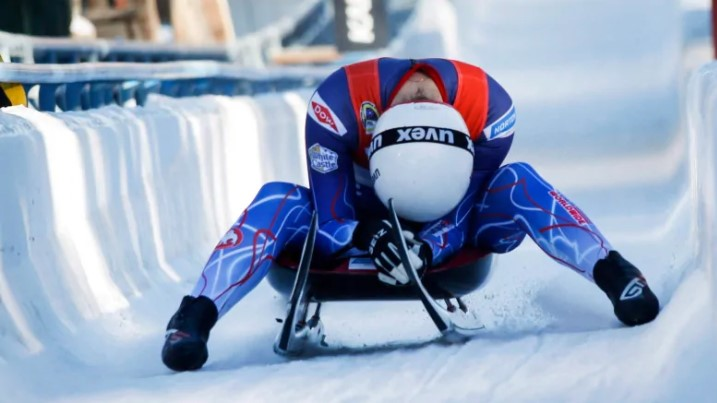 Summer Britcher of the United States reacts to her fifth place finish in the women's World Cup luge competition in Calgary in 2018. The World Cup will move to B.C. in 2021.(Jeff McIntosh/The Canadian Press)