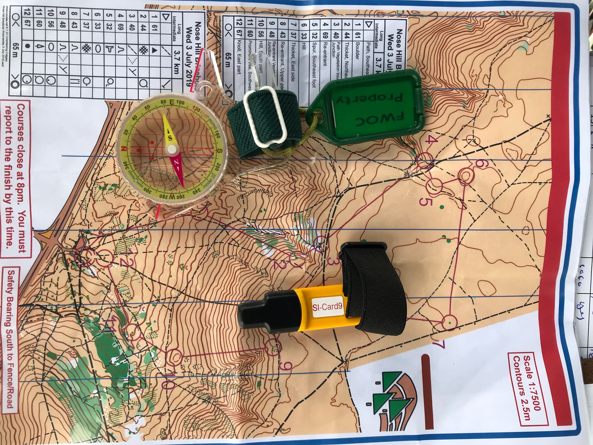 My Orienteering gear (compass, finger stick and my map)