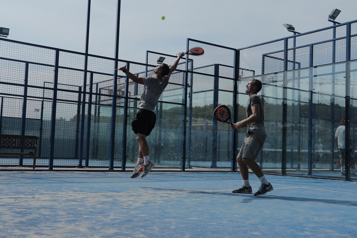 Two guys playing padel