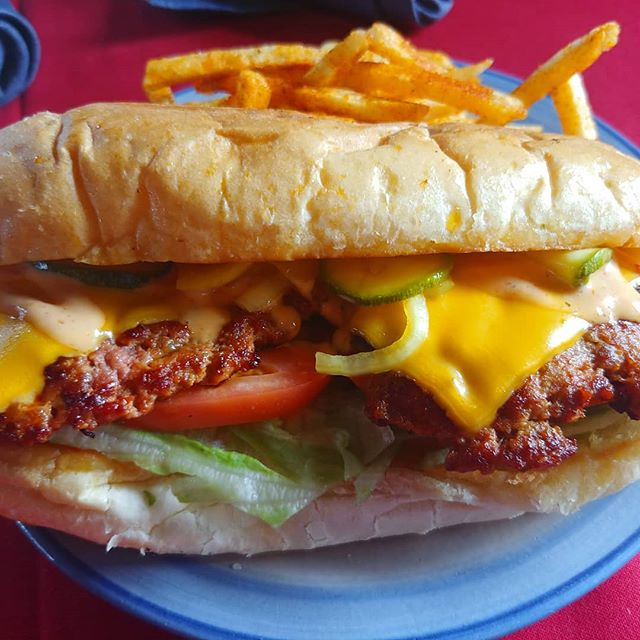 "Spicy #nola Sausage #poboy today cause @erniedizzle threatened the Rev with physical violence. ""Its a great sandwich, please don't hurt me."" Says the Rev.  #nkyfood #cincyfood #lovethecov #sausage #spicy #mainstrassevillage"