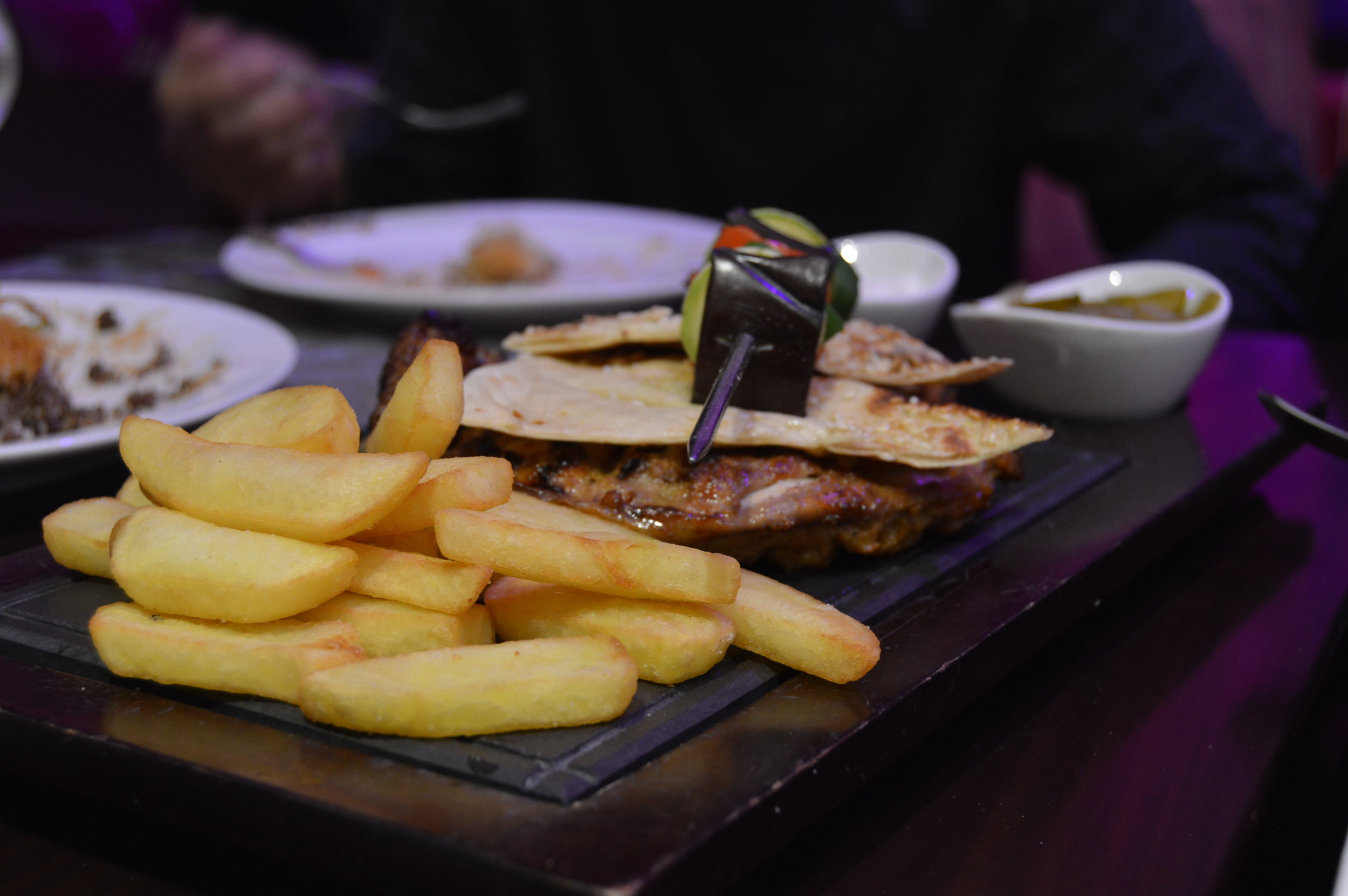 Lebanese dinner: - hummus, usmaleih, halloumi, garlic bread, grilled veggies and chicken