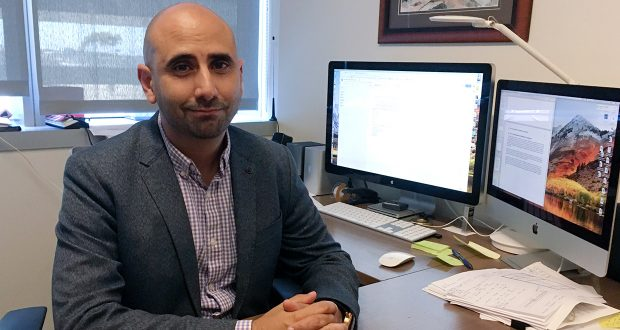 Dr. Fatta Nahab, a neurologist who directs the Functional Imaging of Neurodegenerative Disorders Lab at the University of California San Diego Health's Movement Disorder Center, sits at his desk Monday, Sept 17, 2018, in San Diego. Nahab spent years going through regulatory hoops to get approval to import marijuana from Canada, to study whether cannabis can help treat essential tremor, a shaking condition affecting millions of people. (AP Photo/Julie Watson)
