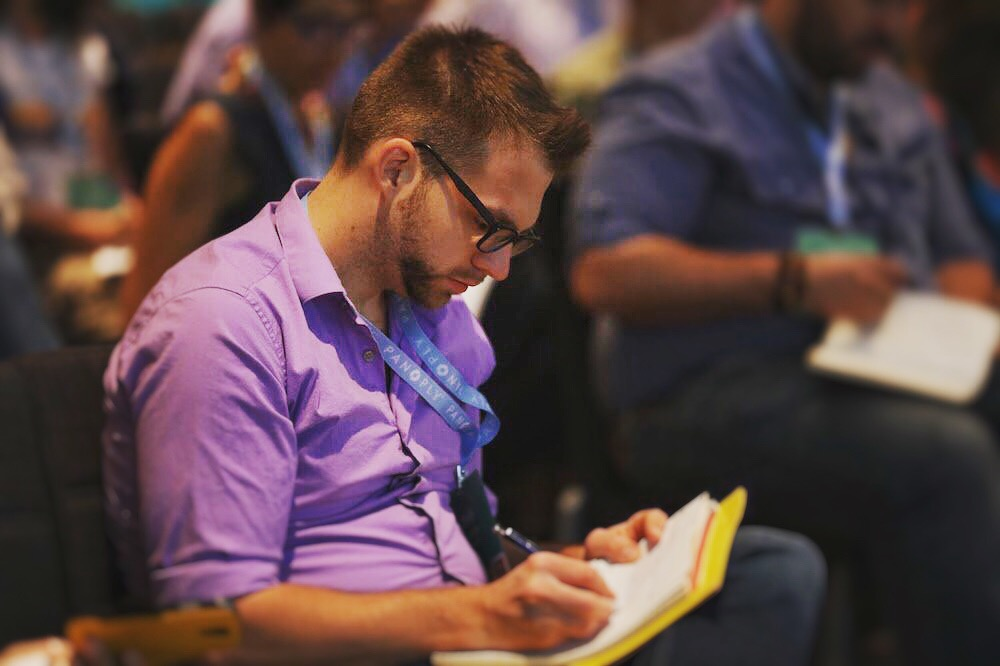 Founder, Ryan Martin, taking notes at Podcast Movement 2017.