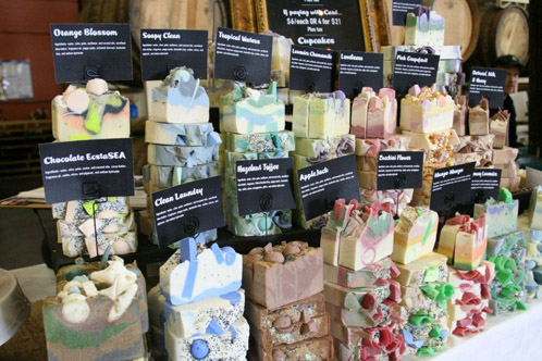The Daily Scrub's eye catching craft fair display. Selling at a craft fair or farmers market allows customers to touch and smell product.