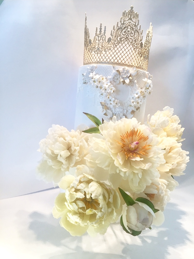 A small cake can look like just as regal and dramatic as any other cake many times it's size! Edible lace, floral filagree and angelic sugar peonies will ensure a statement to be remembered!