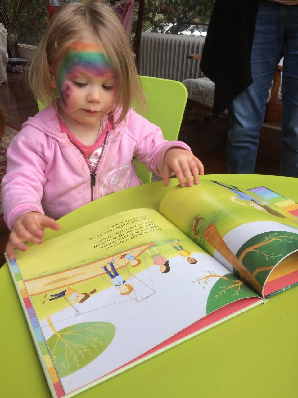Felicity reading Reena's Rainbow.jpeg