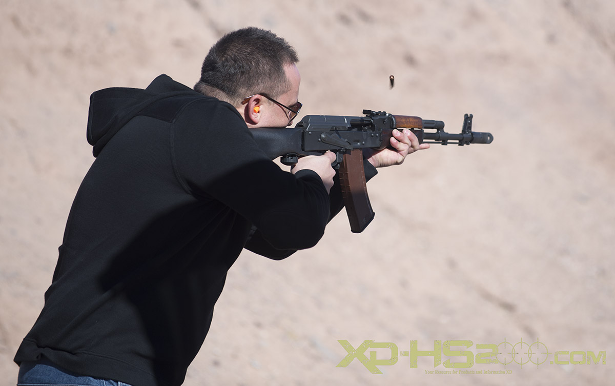 Member of the firearms press experiencing the AK-47 and Slide Fire stock. There is also a slide fire stock available for a sorting version of the Saiga.