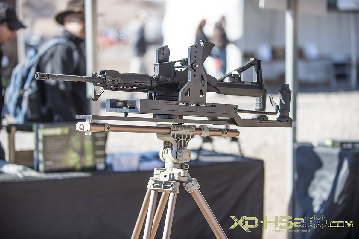 Slide Fire had a cradle on a tripod that allowed the mount to do all of the bump firing. All the user had to do is pull the paddle trigger.