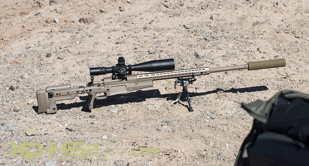 I did not get the model, but this is an Armalite rifle in 300win mag suppressed and toped off with a Night Force scope.