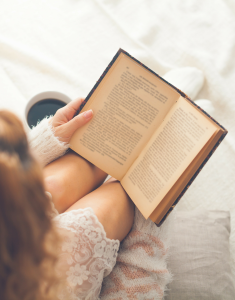 woman-reading-in-bed-235x300.png