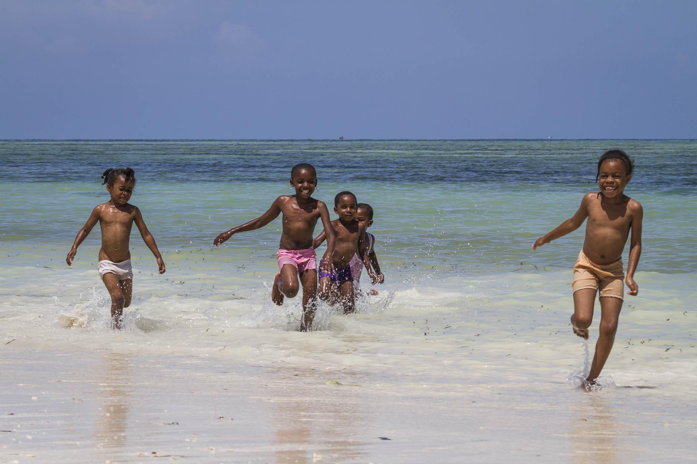 Zanzibar, Tanzania.  Happy kids running to greet us.