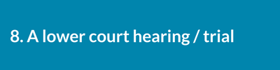 A lower court hearing / trial..