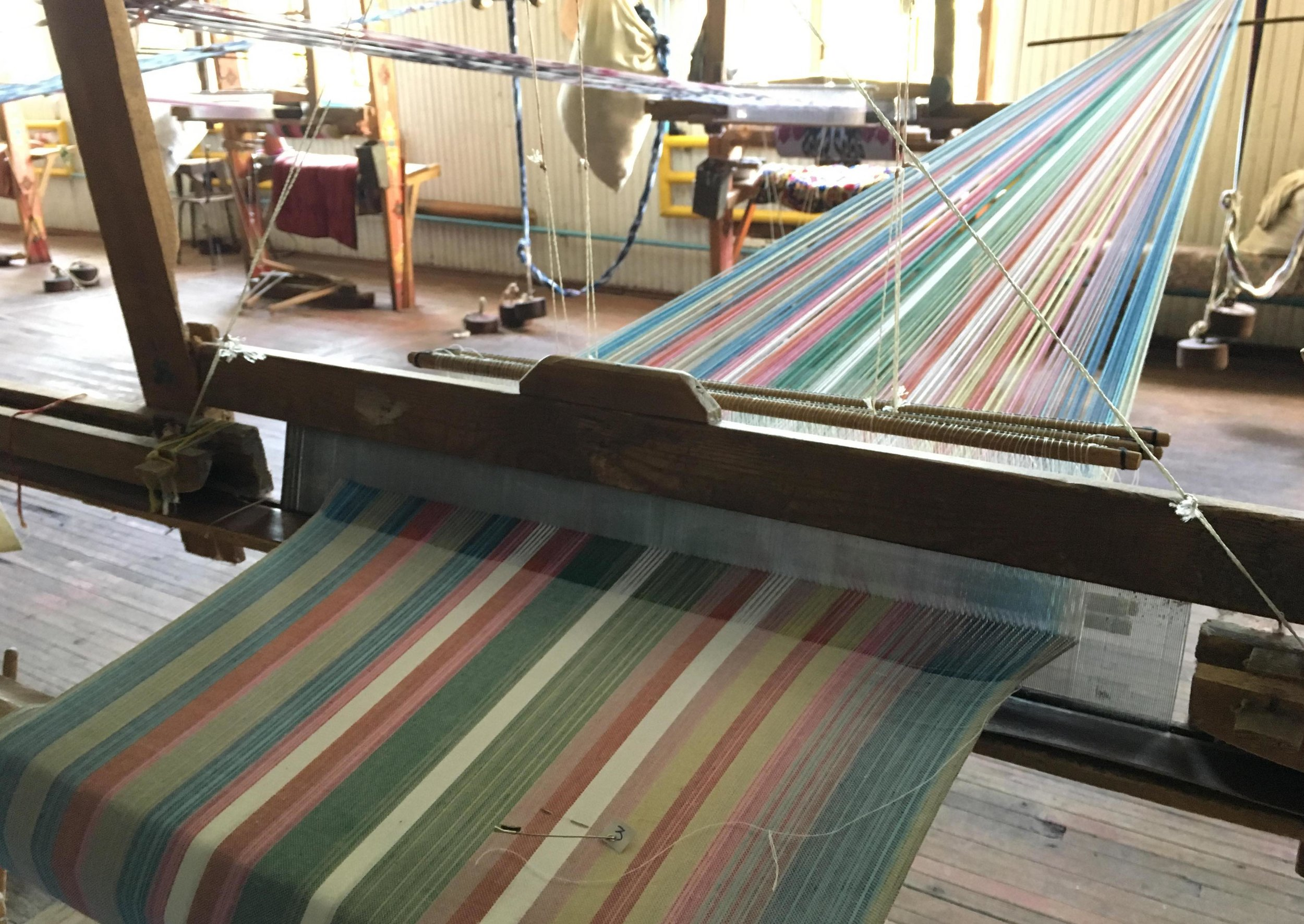 Work in progress at a weaving loom with silk and cotton