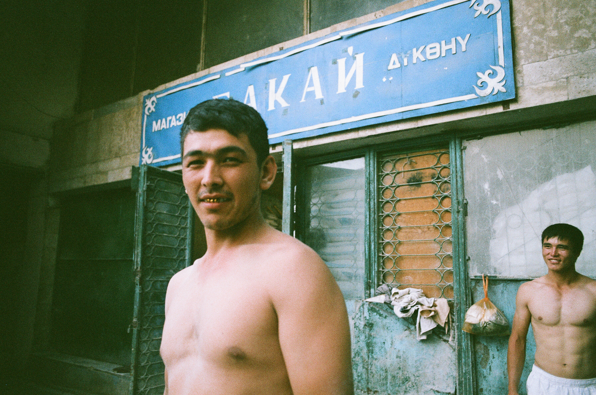 Golden smile! Its common for central asian countries to use metal teeth crowns that look golden when people smile