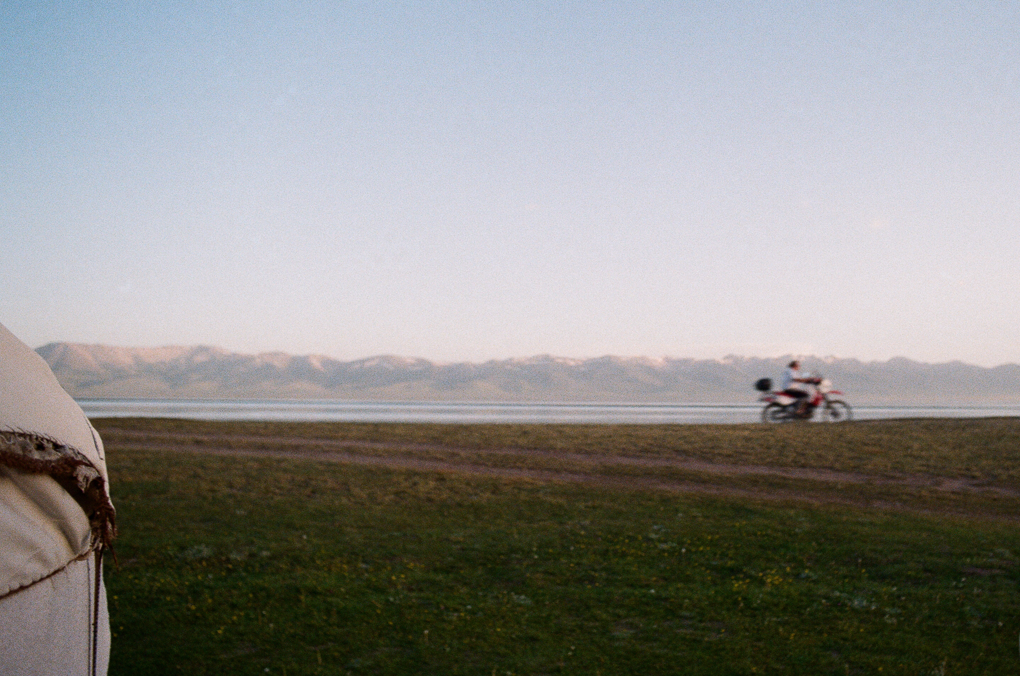 Evening at a yurt camp surrounded by ridges