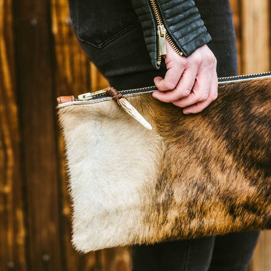 Hide Altitude - Jackson Hole, WYJacqueline and Patricia Barrett, the founders of Hide Altitude, have always been in search of a simple but elegant bag. Our bags were inspired from Jacqueline's experience of living in Jackson Hole and a trip to Bariloche, Argentina. While in Argentina they were surrounded by the highest quality and most beautiful sheep shearling, which inspired the June Clutch, named after Jacqueline's beloved and stylish Grandmother. Each bag is individually made with its own unique cowhide or shearling flap, as well as the HA brand stamped on the back.www.hidealtitude.com | @hidealtitude