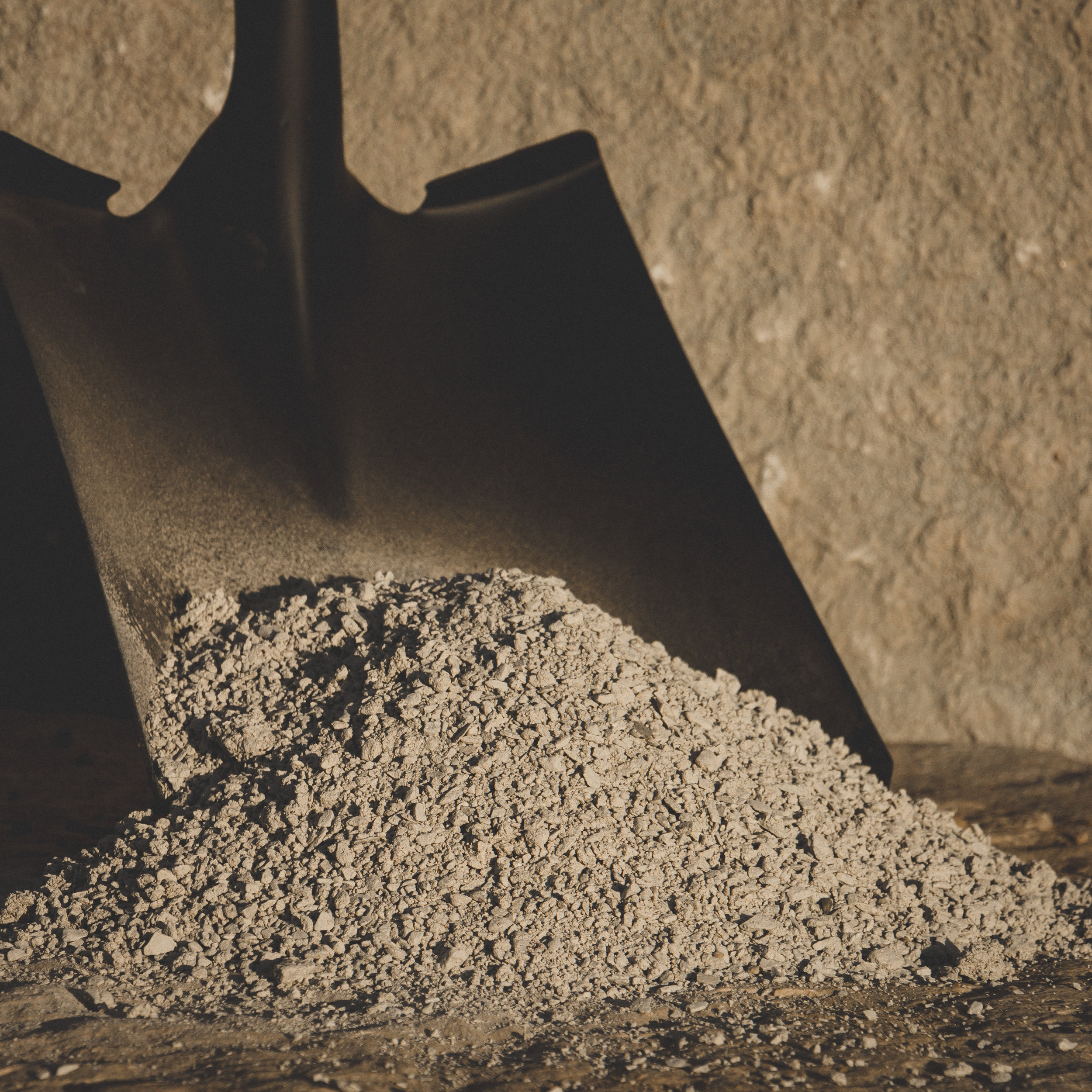 Limestone Screenings - Finely crushed limestone used as a leveling and base material.