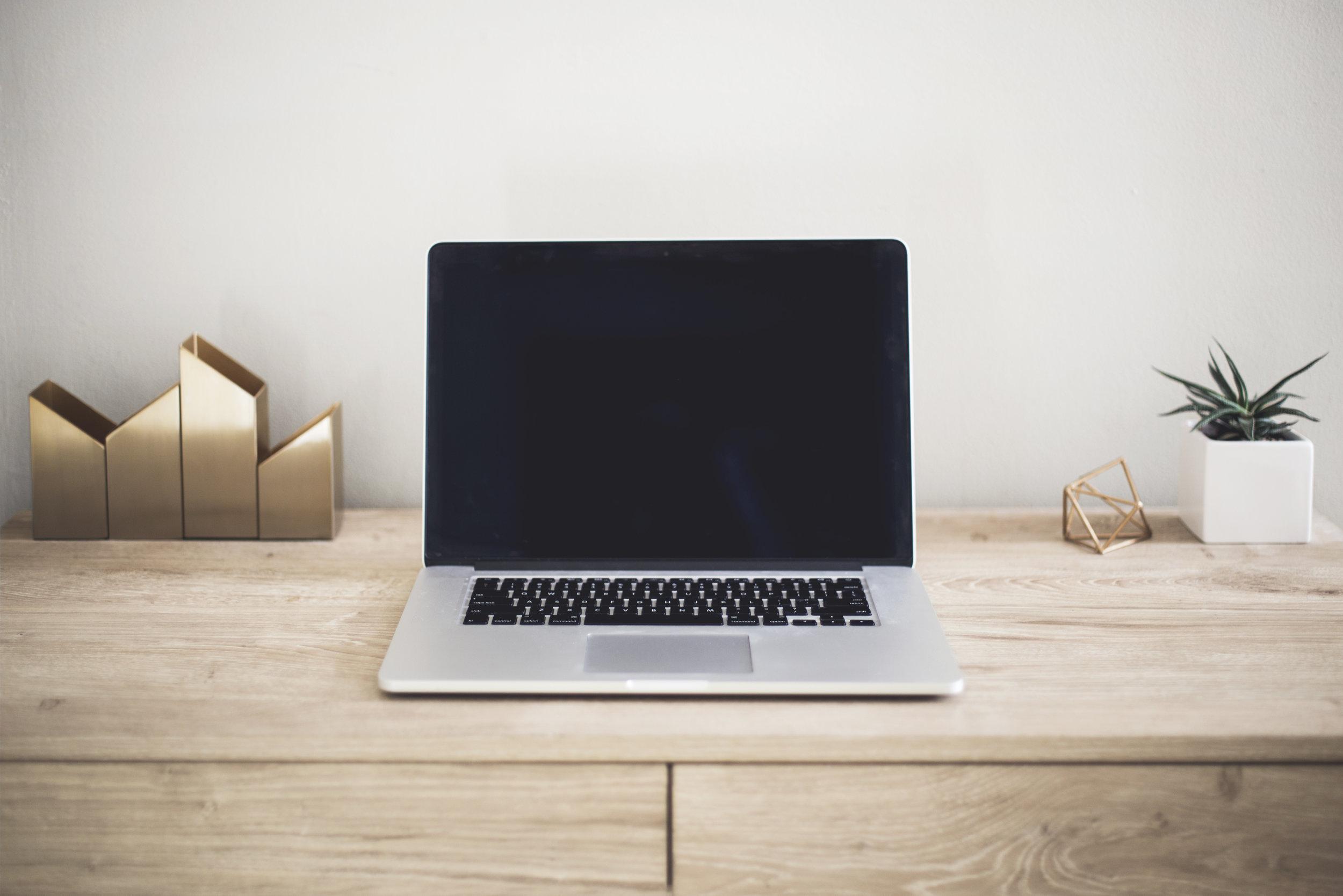 Laptop computer on a desk.