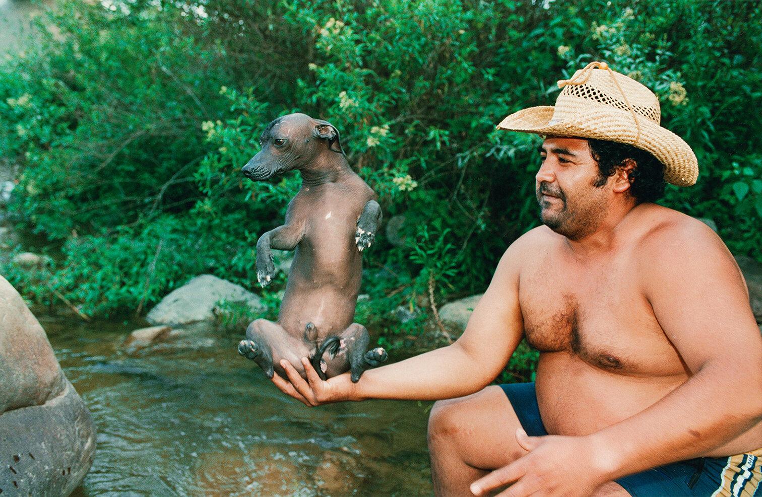 34 Hombre con perro pila en el río Lesser Man in the river with pila dog (pila is his pedigree) 2001.jpg