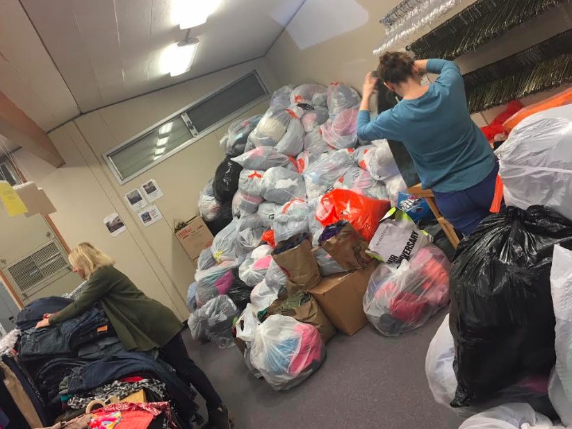 Volunteers sort through a mountain of donations.