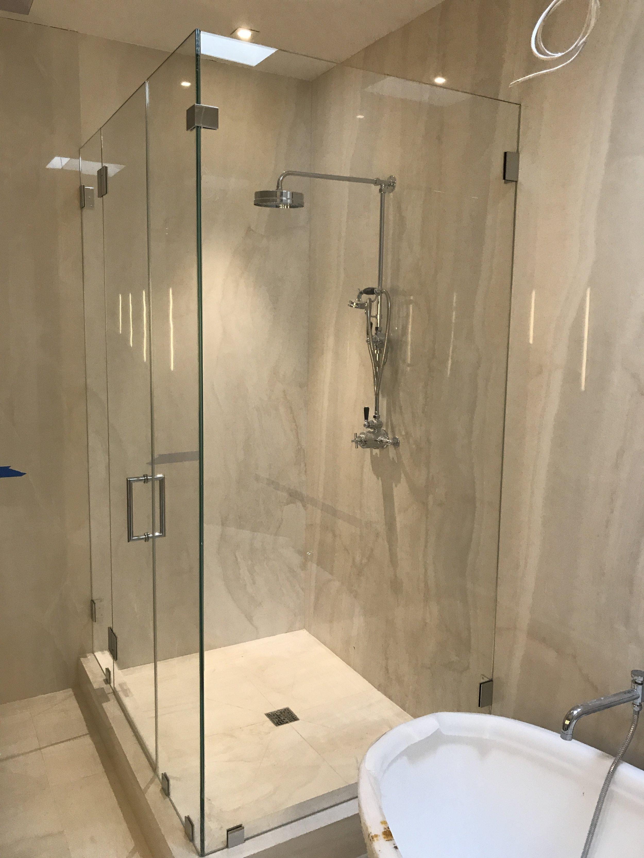 Tiled Shower gets a new Glass Door
