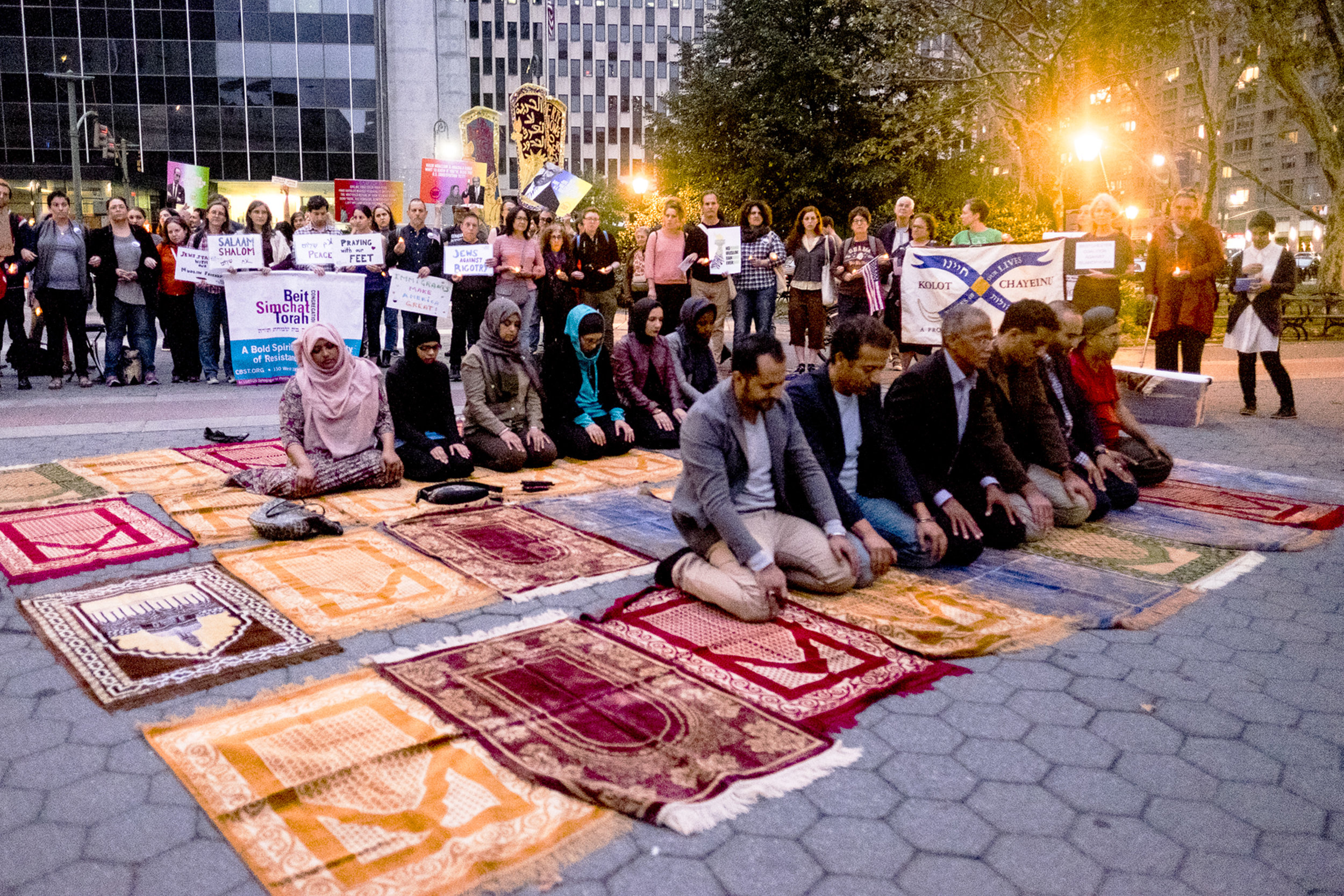 at prayer with supporters.jpg