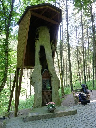What remains of the 700 year old oak tree is carefully preserved and still houses the Black Madonna.
