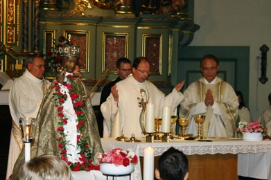 the Black Madonna in full regalia during a pilgrimage mass celebrated by Bishop Ackerman and other priests