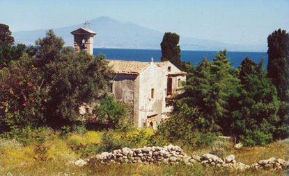 The sanctuary with Mt. Etna in the distance. The cave of Adonai was expanded into a small church.