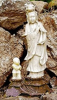 child giving Kuan Yin with baby boy