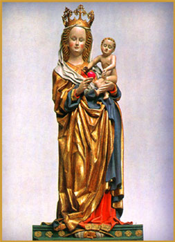 """Madonna handing Jesus the no longer forbidden fruit of knowledge,15th century statue in the church """"St. Maria Koenigin""""in Cologne, Germany"""
