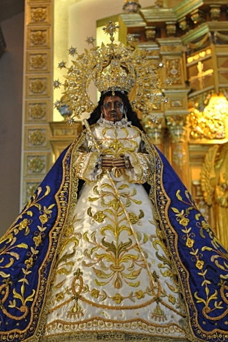 "The ""Vicar"", i.e. religious substitute image of the Black Madonna of Antipolo. She is a copy that travels around, dispensing the graces of her mother-statue. Our Lady of Fatima has a similar pilgrim-statue, which travels the world. Photo by  Ellis Manuel Mendez"