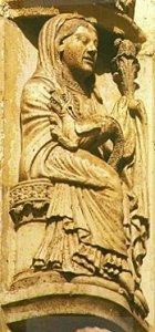 """María sosteniendo un dragón domado como un perro faldero, un tipo de estatua muy raro. Chartres, relieve en la """"Puerta Real""""."""
