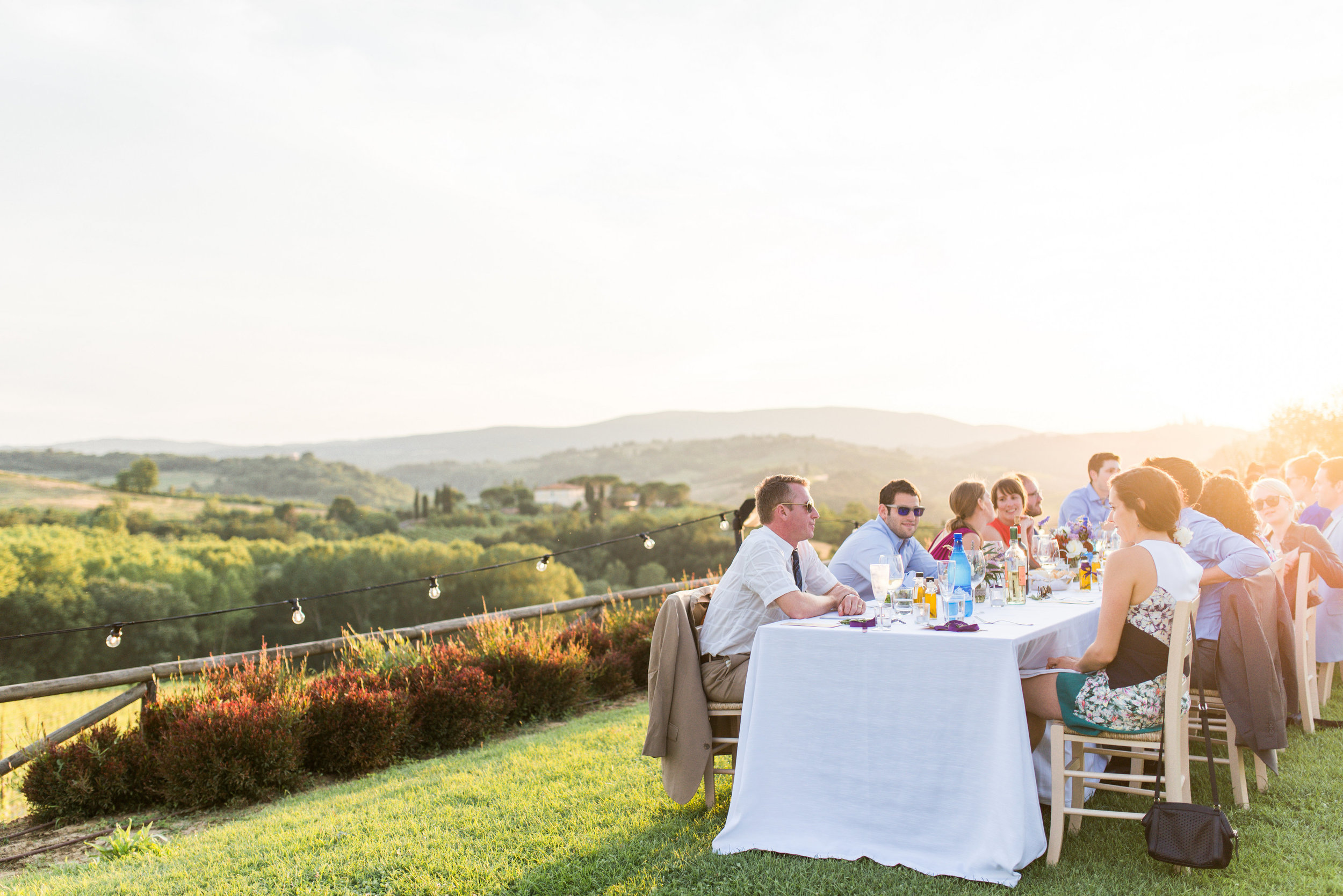 millennials-eating-together-stunning-view-in-tuscany-italy-around-sunset_t20_WQdAoY.jpg