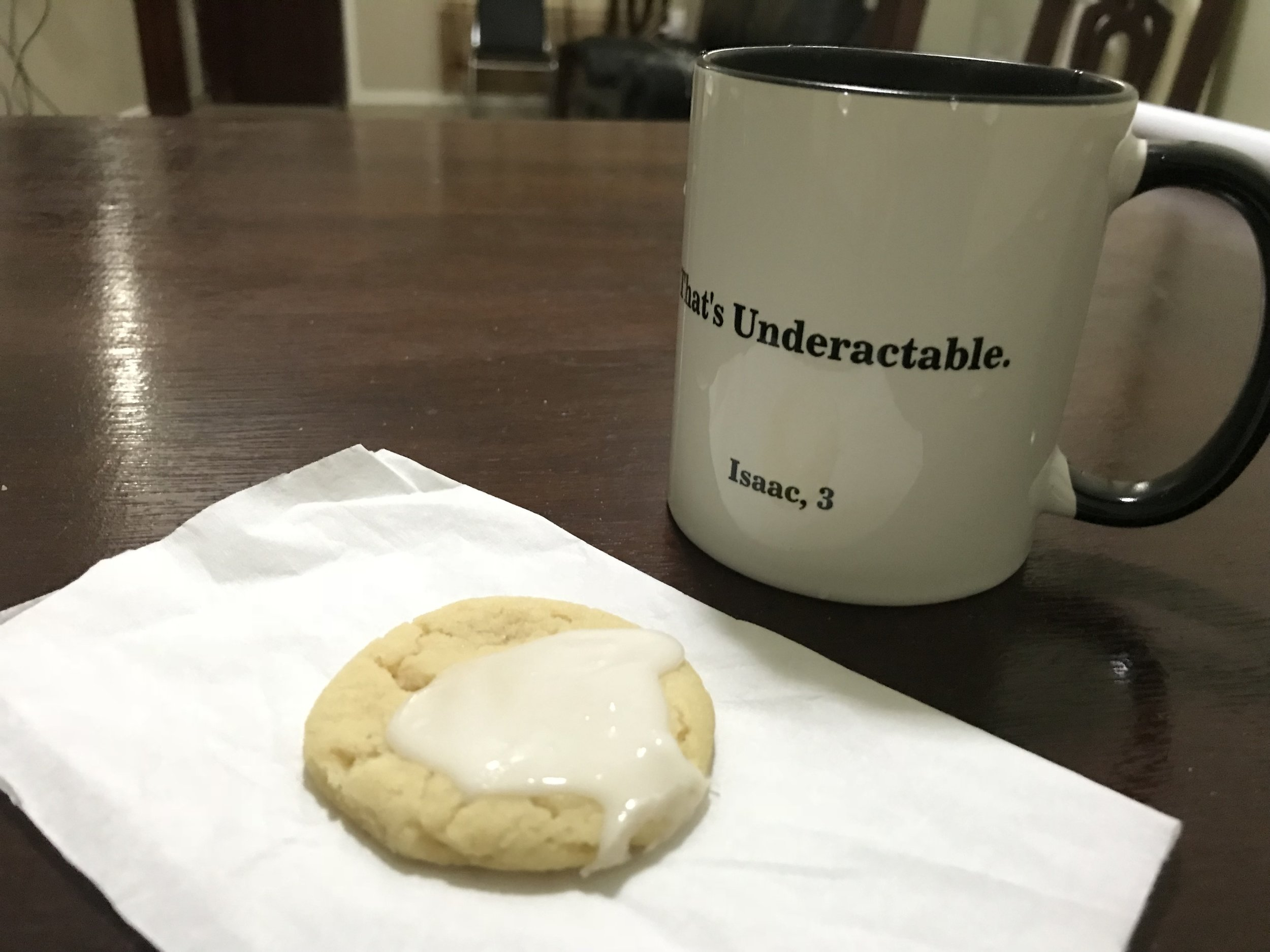 Having a leftover Christmas cookie with some tea.