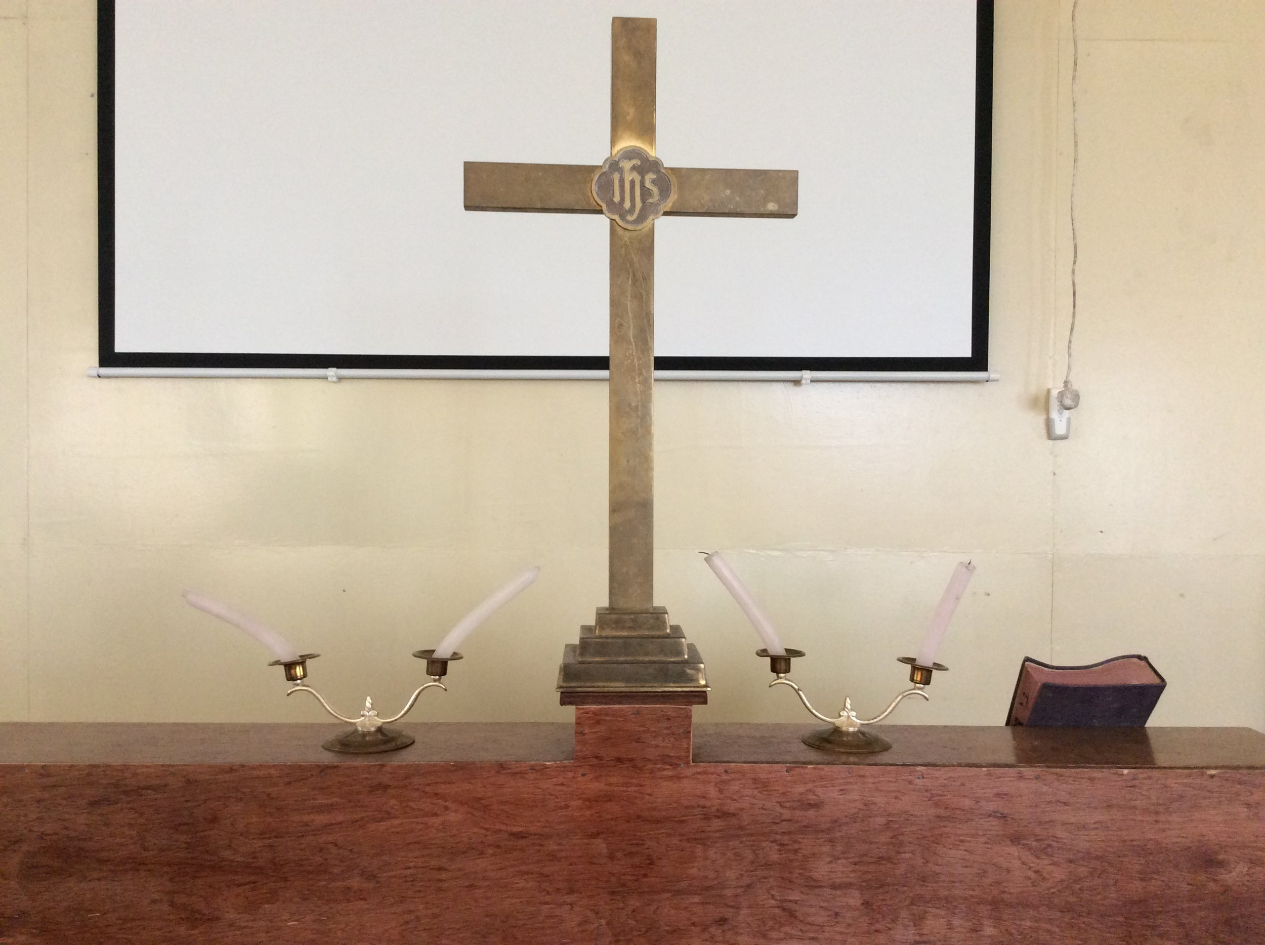 The altar at the School of Theology. We lit three candles for advent. Notice how the candles lean. Africa heat is no joke!