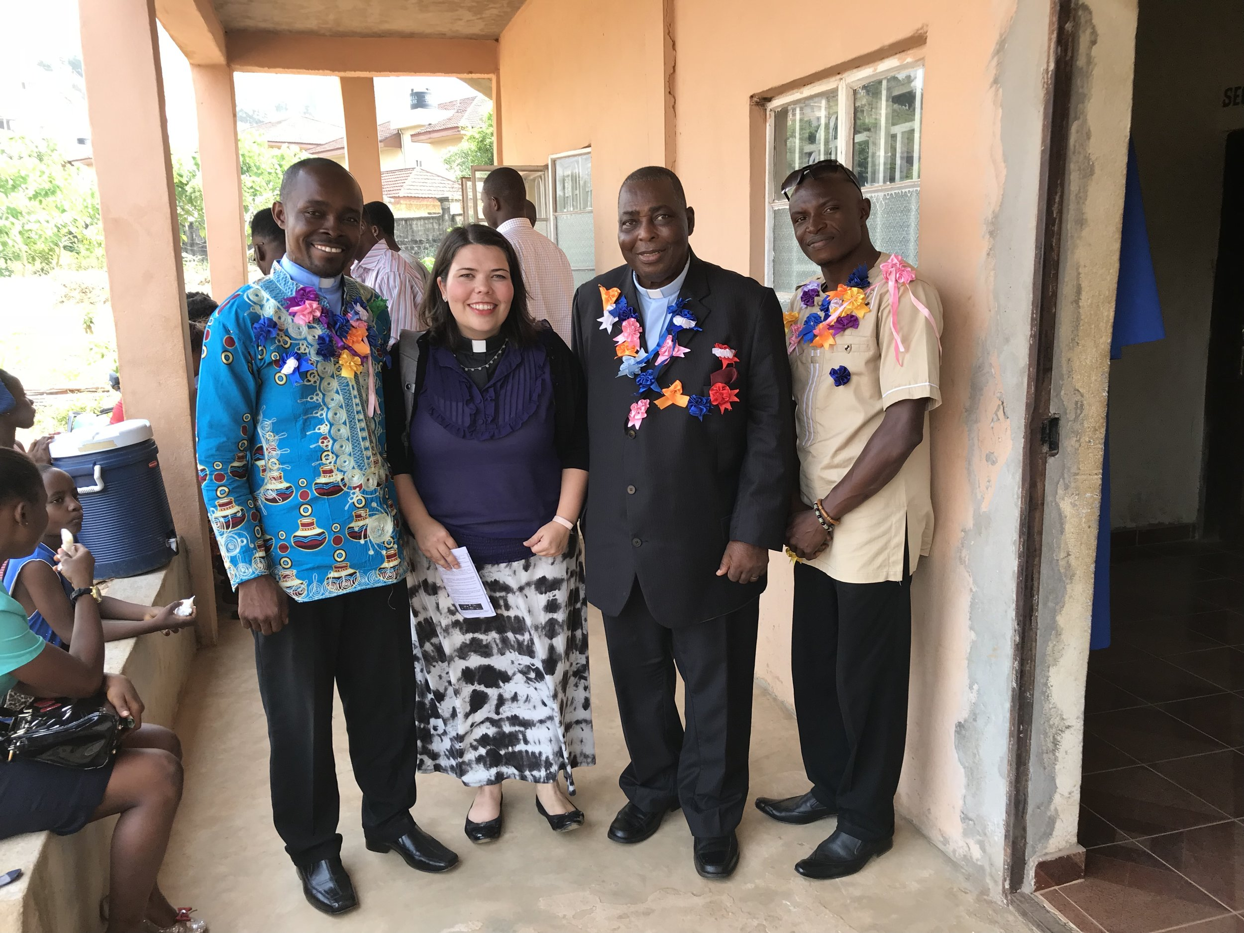 The pastors of Milton Margai Memorial UMC. Notice the ribbons. The senior pastor is Rev. Victor Kainboy on the left. Then the associate pastor who is also a civil engineer. Then on the right is an evangelist. Evangelists are a special set of pastors here.