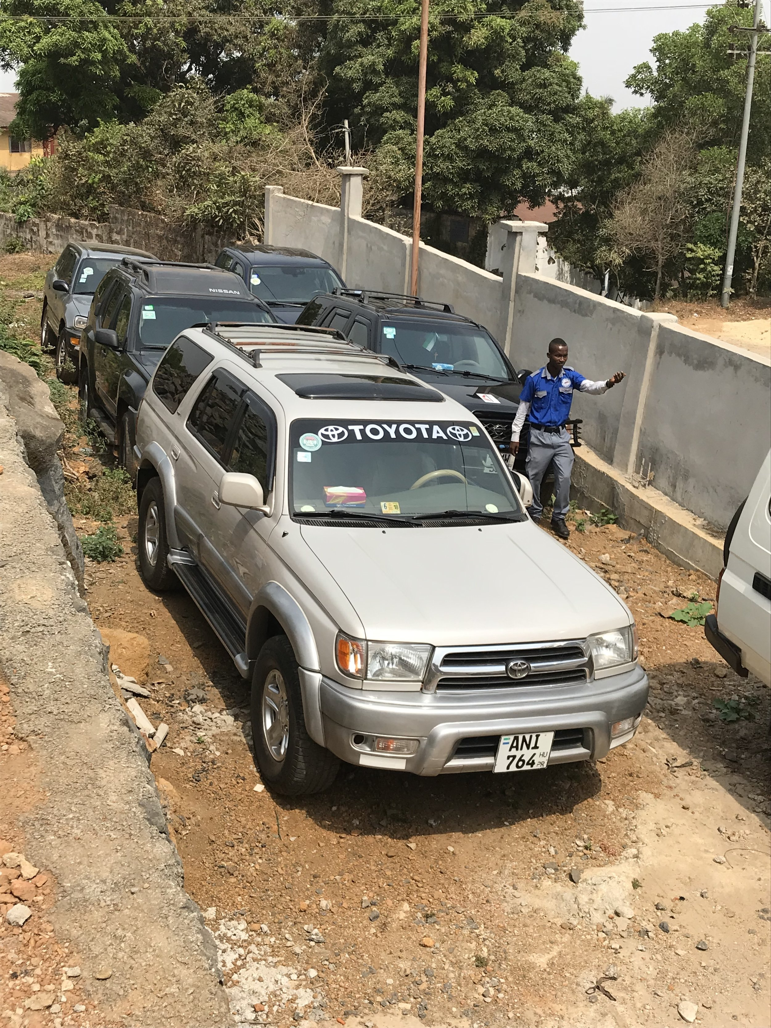Parking is always an issue in Freetown. They packed us in close. My truck is at the very back. Those of you who know me know that this introvert heart was freaking out internally. I like to at all times have an escape route.