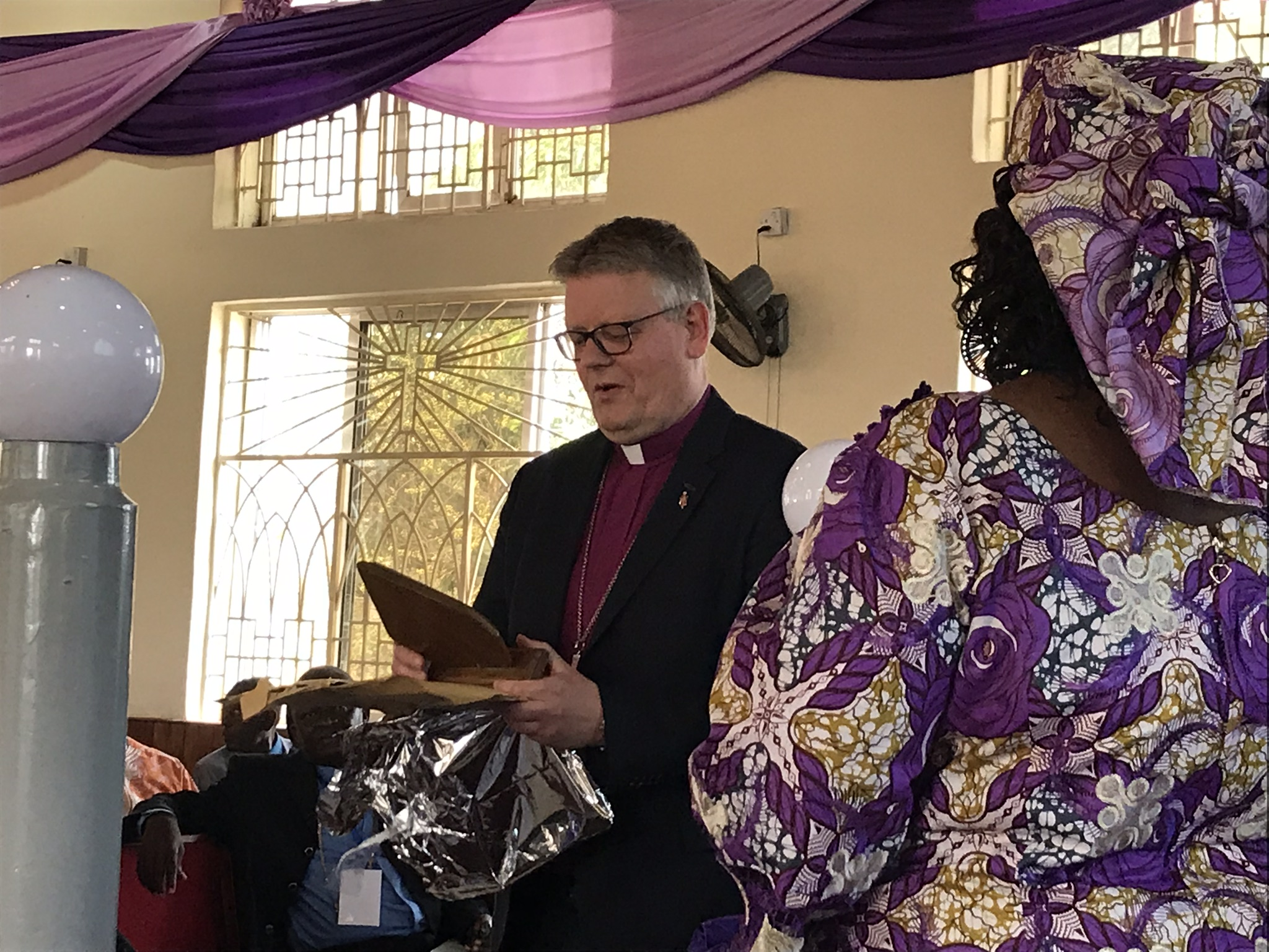 Presenting gifts to the international guests.  This is Bishop Alstead from the Baltic Area in Europe.  This is a generous gift-giving culture.
