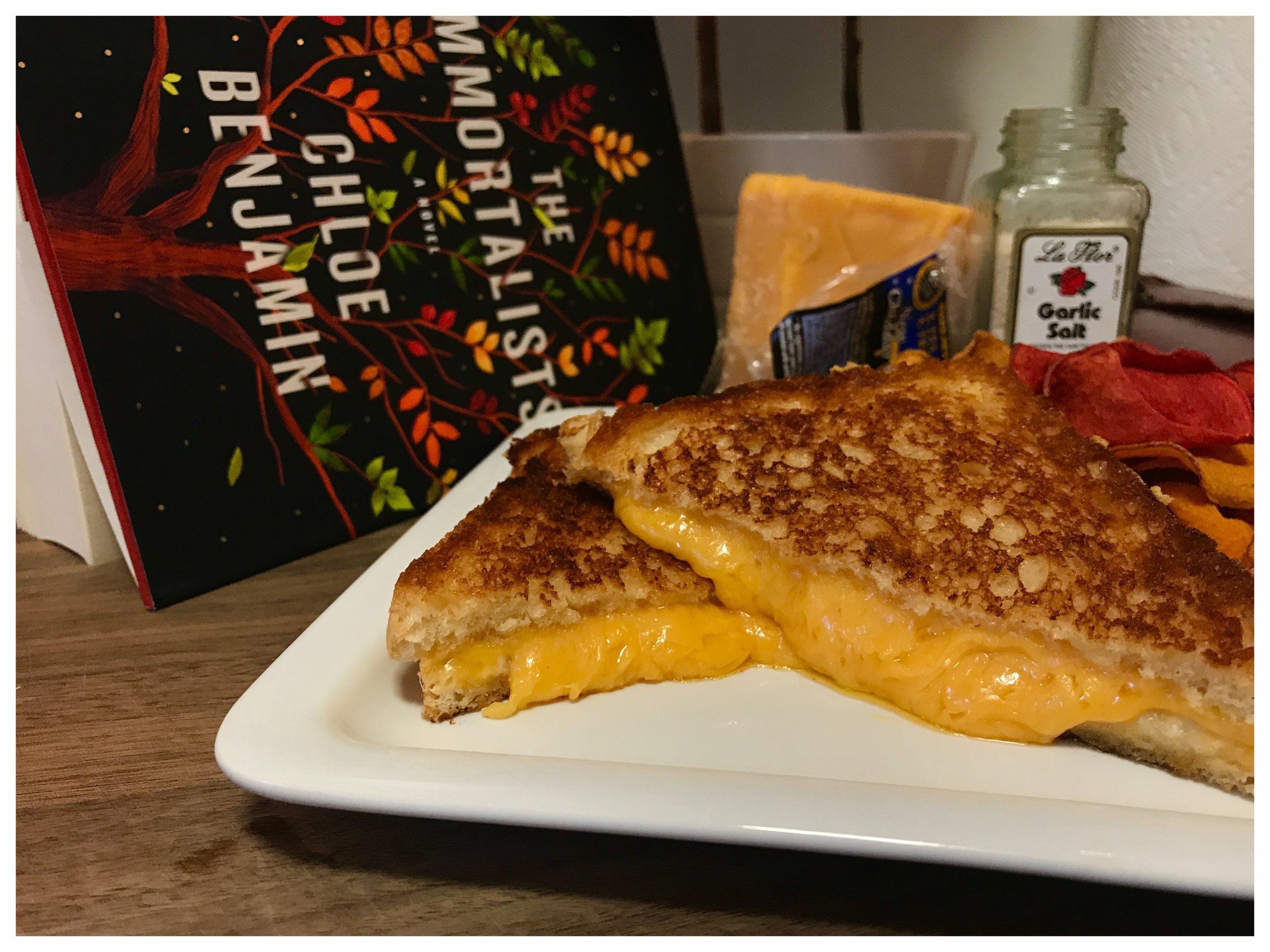 Ingredients:Two slices of White Bread, unsalted Butter, aged (18 months) Cheddar Cheese, and Garlic Salt.