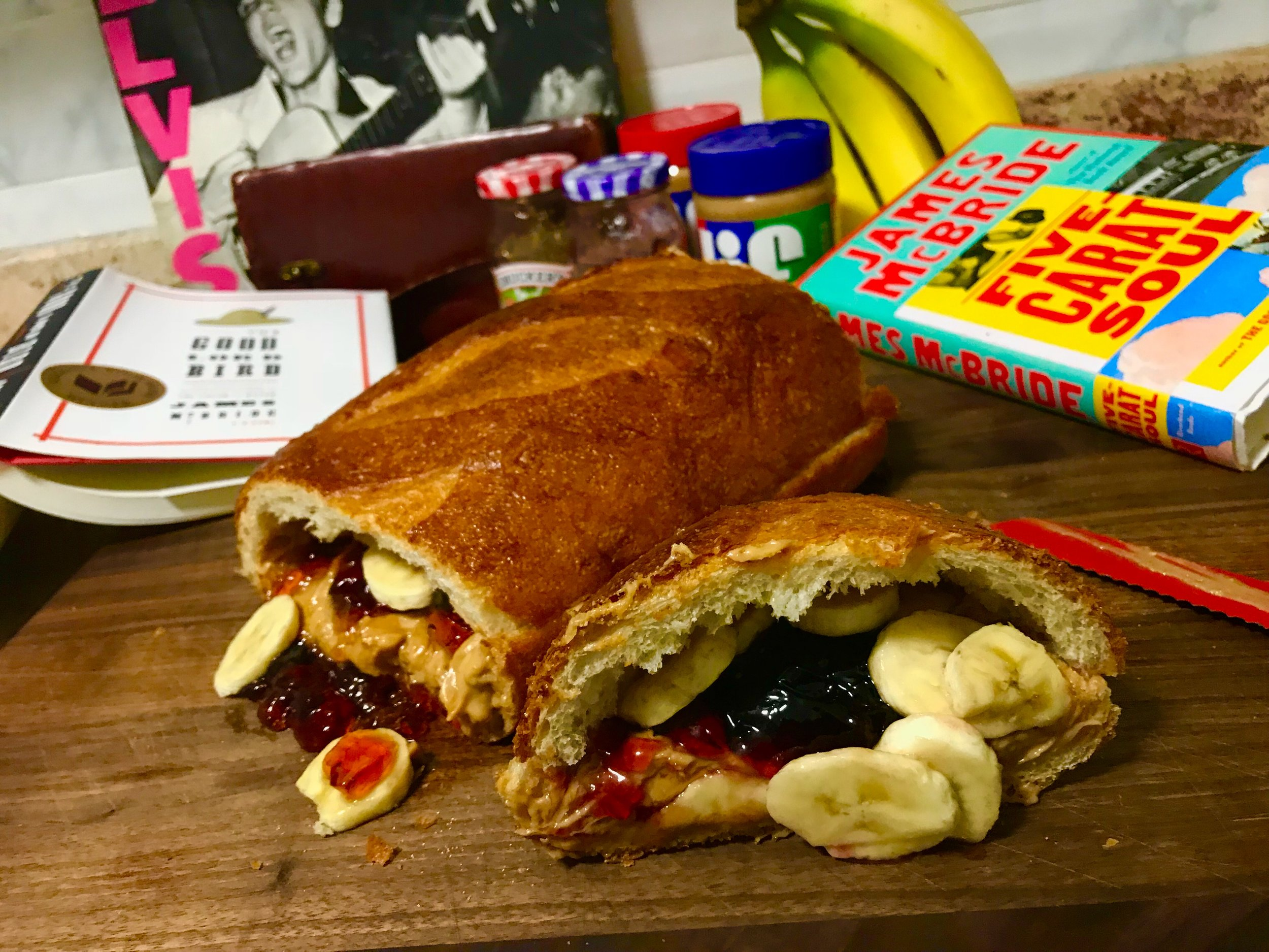 Ingredients: An entire loaf of bread from Brooklyn's own  Baked In Brooklyn , 1/2 a jar of Jif creamy peanut butter, 1/2 of Jif crunchy peanut butter, 1/2 a jar of Smucker's Grape jelly, 1/2 a jar of Smucker's Strawberry jelly, 3 bananas (sliced), and butter. Preparation inspired the (in)famous Fool's Gold sandwich made popular by Elvis Presley.