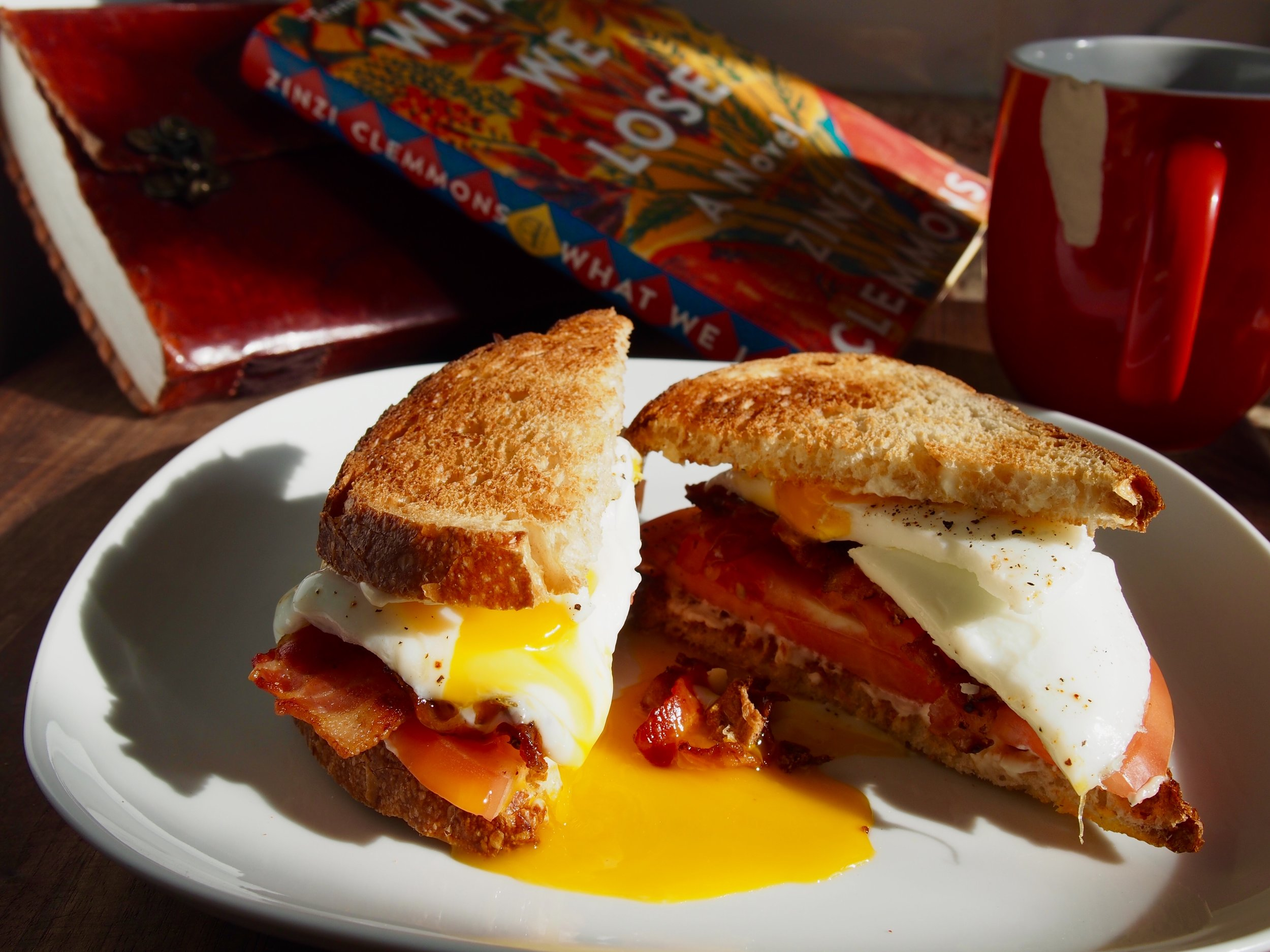 Ingredients: Toasted Sourdough bread, fried eggs (sunny-side up and yolky), bacon , tomato, and mayonnaise.