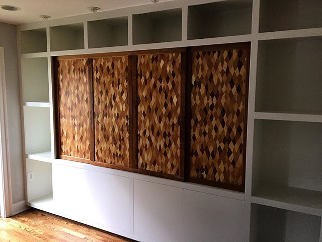Two years ago, I made & installed built-in #cabinetry for a wonderful customer in Arlington, VA.  She wanted open #cabinet space to display art objects, covered space for storage, and an artful way to conceal the TV.  She also wanted a clean, minimal look with no hardware or metal showing.