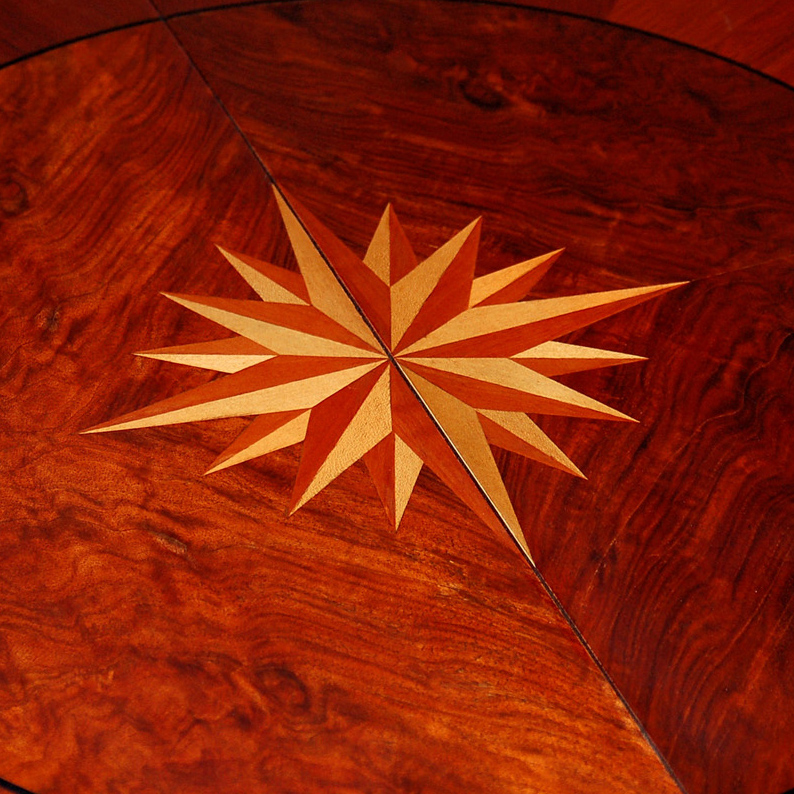 Compass Rose within Makore Burl   This is the look that comes from a compass rose inlaid within a burl grain pattern.