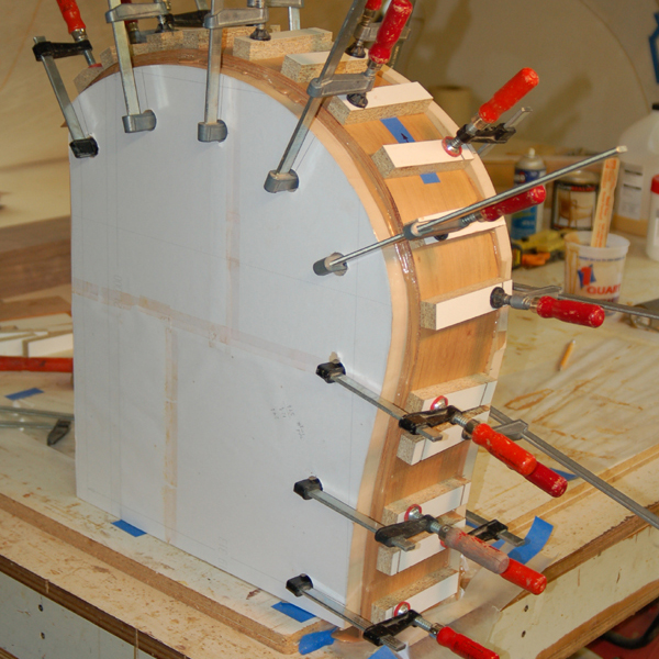 """Bent Lamination Glue-up   This is the form made for producing curved legs. This is a 12-layer lamination for a final thickness of 3/4""""."""