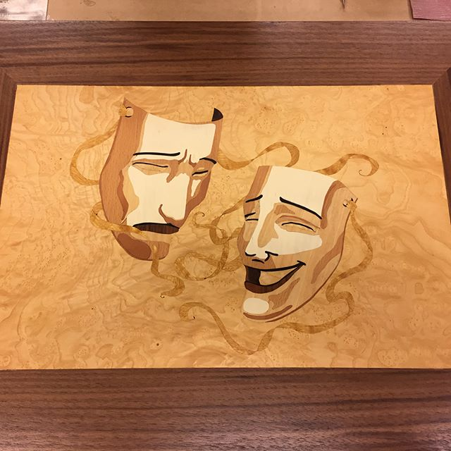 Recent #marquetry work for a #traytable I call 2TRAYS/4TABLES.  A reversible tray is paired with a turnable  base that holds the tray at coffee table height, or, end table height.  Made as a gift for a newlywed couple who are both #actors, using the #comedytragedy masks icon.  Original artist of this image is unknown, but it's a beautiful image.