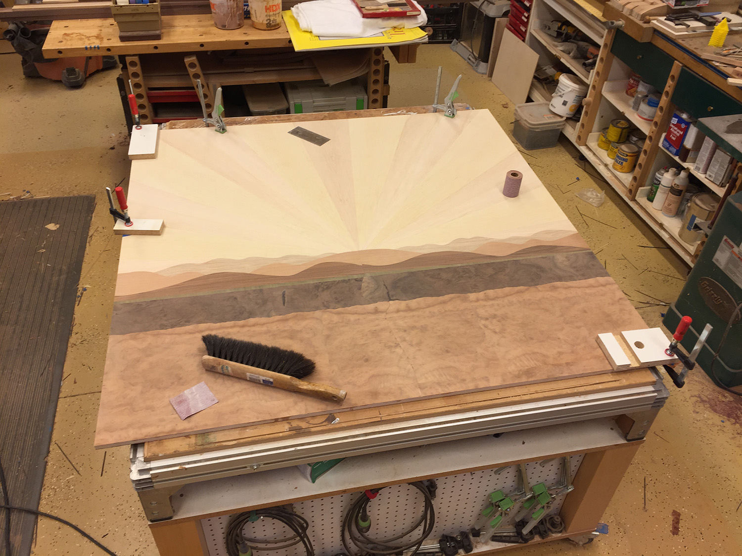 Sanding and making repairs to loose edges.