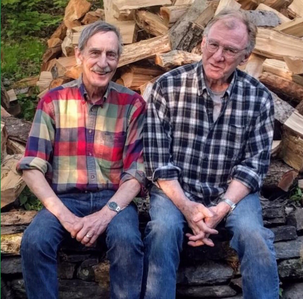The Full Vermonty  authors, Bill Mares and Jeff Danziger, in front of Jeff's woodpile in West Dummerston, Vermont.