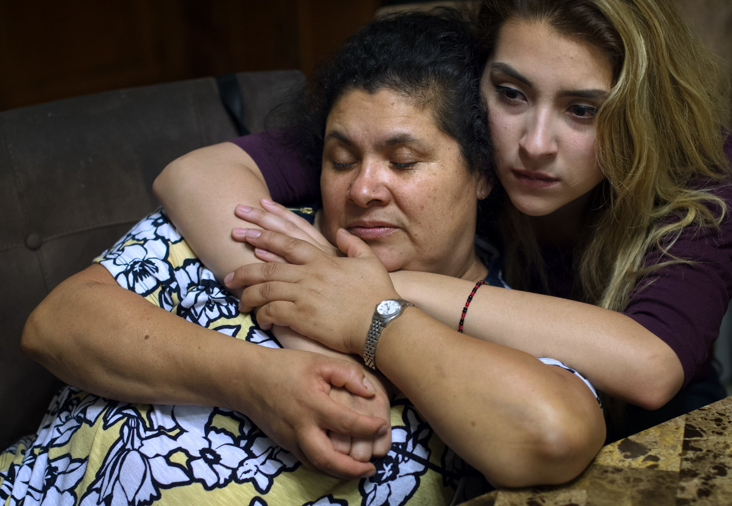 From left, Lourdes Salazar Bautista and her daughter Pamela Quintana-Salazar, 19, embrace during a meeting with anti-deportation campaign leaders at Bautista's home in Ann Arbor, Michigan, USA. The family hopes that Quintana-Salazar will file for a pardon when she turns 21, to fight her mother's 10-year ban from the U.S.